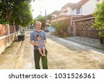 portrait of father and baby son ... | Shutterstock . vector #1031526361