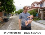 portrait of father and baby son ... | Shutterstock . vector #1031526409
