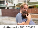 portrait of father and baby son ... | Shutterstock . vector #1031526439