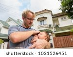 portrait of father and baby son ... | Shutterstock . vector #1031526451