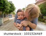portrait of father and baby son ... | Shutterstock . vector #1031526469
