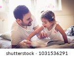daddy read me a fairytale.... | Shutterstock . vector #1031536291