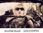 Retro Woman Behind Steering...