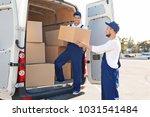 delivery men unloading moving... | Shutterstock . vector #1031541484