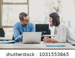 two colleagues monitoring... | Shutterstock . vector #1031553865