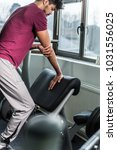 sporty man stretching forearm...   Shutterstock . vector #1031556025