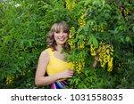 outdoor spring portrait of a... | Shutterstock . vector #1031558035
