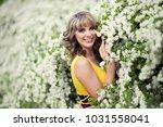 outdoor spring portrait of a... | Shutterstock . vector #1031558041