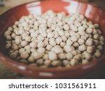 red dish full of chickpeas ... | Shutterstock . vector #1031561911