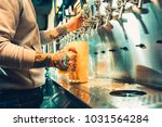 hand of bartender pouring a... | Shutterstock . vector #1031564284