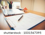 contract for the sale of a new... | Shutterstock . vector #1031567395