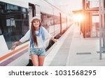 traveler girl waiting and ... | Shutterstock . vector #1031568295
