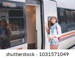 traveler girl waiting and ... | Shutterstock . vector #1031571049
