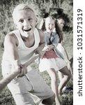 children playing tug of war... | Shutterstock . vector #1031571319