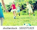group of happy young children... | Shutterstock . vector #1031571325