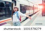 traveler girl waits train on... | Shutterstock . vector #1031578279