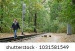 young man walks between the... | Shutterstock . vector #1031581549