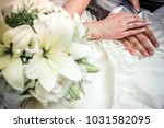 newly wed couple's hands with... | Shutterstock . vector #1031582095