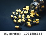 pills in capsules | Shutterstock . vector #1031586865