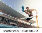close up of a runner jumping... | Shutterstock . vector #1031588215