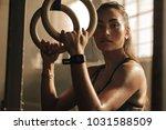 determined woman exercising... | Shutterstock . vector #1031588509