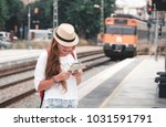 traveler girl with map  hat and ... | Shutterstock . vector #1031591791