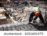 construction workers working...   Shutterstock . vector #1031601475