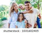 beautiful smiling lovely family ...   Shutterstock . vector #1031602405