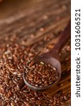 wooden spoon with flax seeds on ... | Shutterstock . vector #1031606521