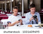 couple of young tourists... | Shutterstock . vector #1031609695