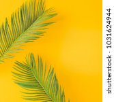 green tropical palm leaves on... | Shutterstock . vector #1031624944