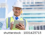 senior engineer man in suit and ...   Shutterstock . vector #1031625715