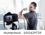bigger biceps. vigorous joyful... | Shutterstock . vector #1031629729