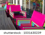 colorful piled up chairs on an... | Shutterstock . vector #1031630239