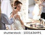 makeup artist preparing bride... | Shutterstock . vector #1031636491