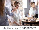 makeup artist preparing bride... | Shutterstock . vector #1031636509
