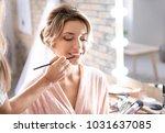 makeup artist preparing bride... | Shutterstock . vector #1031637085