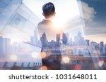 Small photo of The double exposure image of the business man standing back during sunrise overlay with cityscape image. The concept of modern life, business, city life and internet of things.