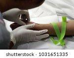 hand of nurse put intravenous...   Shutterstock . vector #1031651335