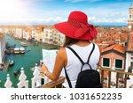 female traveller overlooks... | Shutterstock . vector #1031652235