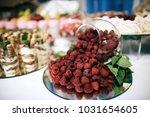 raspberry cake on wedding table ... | Shutterstock . vector #1031654605