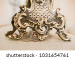 wedding rings next to a... | Shutterstock . vector #1031654761