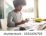 young girl working at her desk | Shutterstock . vector #1031656705