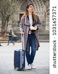 positive traveling woman... | Shutterstock . vector #1031657371