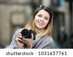 young positive cheerful woman... | Shutterstock . vector #1031657761