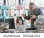angry boss yelling at his young ...   Shutterstock . vector #1031661541