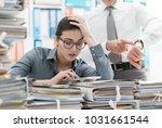 demanding boss pointing to his... | Shutterstock . vector #1031661544