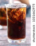 close up to cola in the glass. | Shutterstock . vector #1031662975
