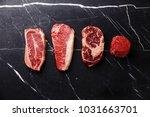 variety of raw black angus... | Shutterstock . vector #1031663701