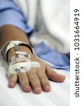 iv solution in a patients hand   Shutterstock . vector #1031664919